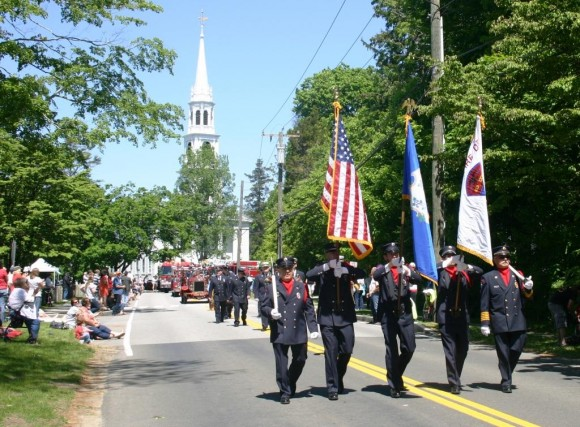 The parade heads down McCurdy towards the cemetery.