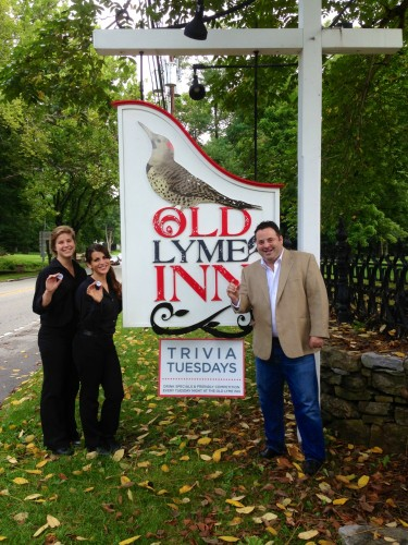 Jason Apfelbaum (right) and two of his staff showing off their motivational poker chips in front of the Old Lyme Inn.