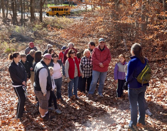 Photo by Bob Lorenz.  Kate Brown of the TPL speaking to a group of hikers participating in the Nov. 16 Preserve hike.