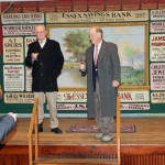 Board member Mark Lander (left) and Co-Chair Tim Griswold (right) address the crowd gathered to celebrate the purchase of the old Lyme Grange by the Old Lyme Historical Society.