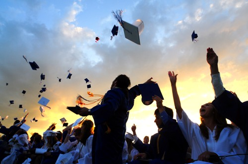 Hats high!  Lyme-Old Lyme High School graduates celebrate their success.  Photo by Kim Tyler.