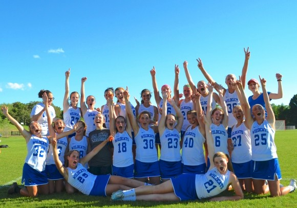 The Wildcat girl's lacrosse team celebrates after its victory over Weston on Friday.