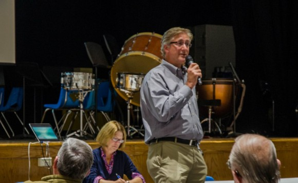 Dr. Gregory Hack, Co-President of the Old Lyme Rowing Association, responds to a question at Monday's meeting.