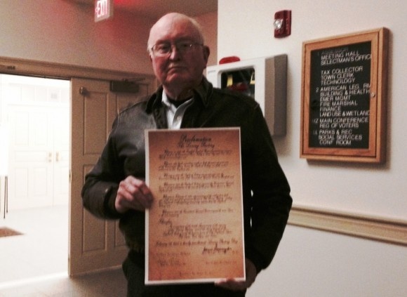 Mark Lander holds 'The Loving Parting Day' proclamation.
