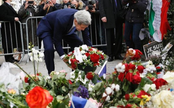 US Foreign Secretary John Kerry pays his respects at the memorial to the Charlie Hebdo victims.