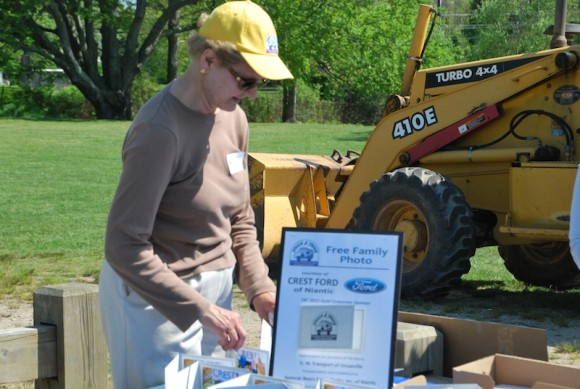 Sally Myers, Chairperson of the 2015 East Lyme Auxiliary Child and Family Agency-Touch-A-Truck event, is seen hard at work in this photo.