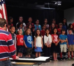 Mile Creek students sing during the Memorial Day program.