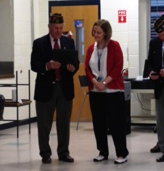 Roger Haynes presents Mary Bradford with a VFW award for Teacher of the Year.
