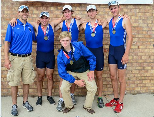 "The boy's first boat gather for team photo with coach Louis Zubek and their gold medals. From left to right standing are Josh Swanski, Liam Corrigan, Jeremy ""Remy"" Newton and Harry Godfrey-Fogg with Thomas Crisp (cox) in front row."