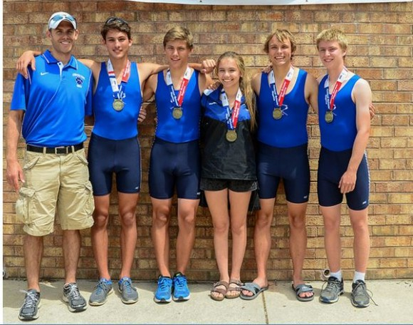 The boys second boat stand with their coach Louis Zubek and their medals. From left to right, Peter Fuchs, Adam Drummond, Julia Morrison (cox) Brandon Green and Jacob Olson.