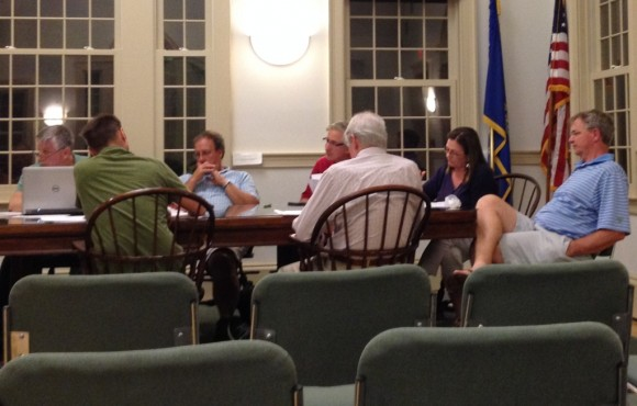 Members of the Hains Park Boathouse Improvement Committee consider the new design proposal.