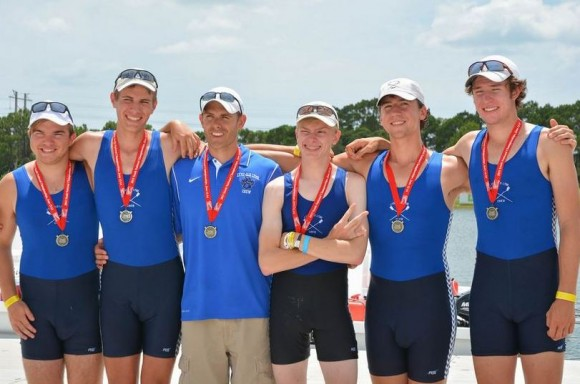 The Us Rowing Junior Nationals silver medal team and (third from left) their coach Louis Zubek.