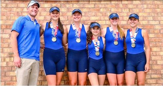 The crew of the girl's first boat proudly display their medals. From left to right, Steve Baranoski (coach), Christiana Congdon, Hannah Paynter, Claudia Mergy (cox), Allison Murphy and Maria Boyle.