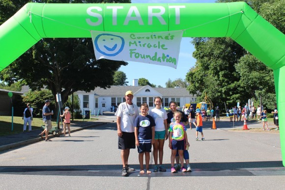 The O'Brien family stand at the starting line.