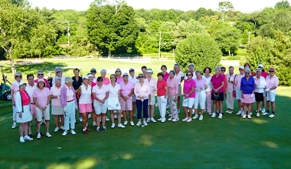 The participants in the Terri Brodeur Foundation benefit at the Old Lyme Country Club gather for a photo.