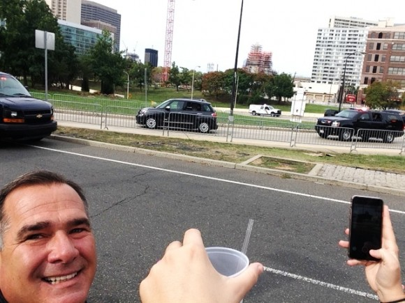 With an excited Kevin Hogan watching, Pope Francis drives by in his famous Fiat