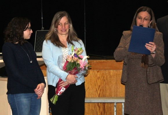 Old Lyme First Selectwoman Bonnie Reemsnyder reads the Citizen of the Year Citation to Seidner (left).