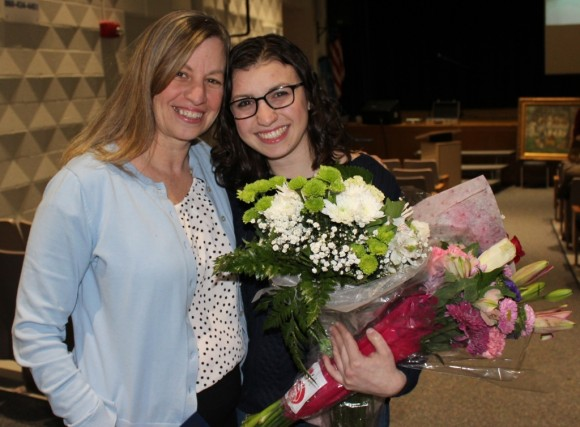 After being named Old Lyme's 2015 Citizen of the Year Mary Seidner receives a hug and a bouquet from her daughter Libby.