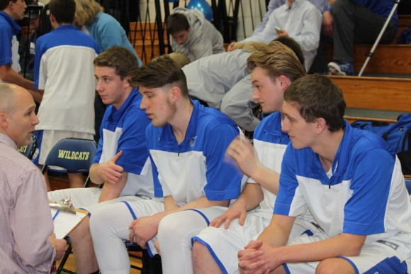 Coach Kaczor gives advice to his seniors during the team's 49-46 victory over East Hampton last Saturday.