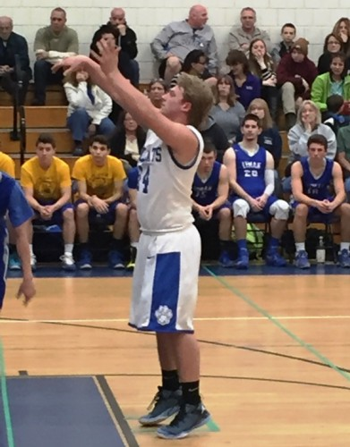 Josh Turkowski makes a shot from the foul line during last night's game against Lyman Memorial.