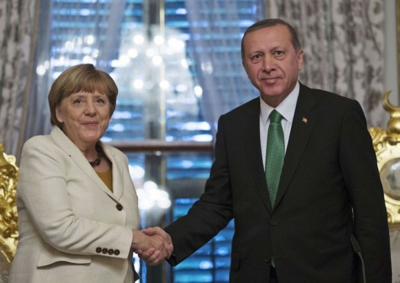 German Chancellor Angela merkel shakes hands with Turkish President Recep Tayyip Erdogan after the historic agreement between the European Union and Turkey.