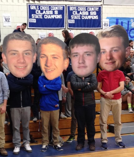 Following a long tradition at Lyme-Old Lyme High School, the seniors pose with oversize cut-outs of their heads used later by the fans to show support for the team.