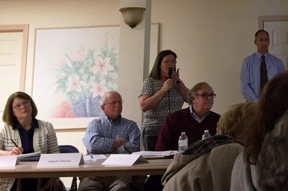 From left to right, Selctwoman Mary Jo Nosal, Sound View Improvement Committee member Angelo Faenza, First Selectwoman Bonnie Reemsnyder (standing), SVIC member Pappalardo and a memebr of engineering member BSC listen to a question from the audience at Monday night's meeting.